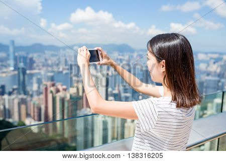 Woman taking photo in Hong Kong