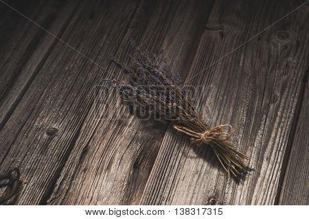 Dried lavender on old wooden background for scrapbooking design
