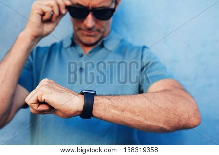 Mature Man Checking Time On His Wristwatch
