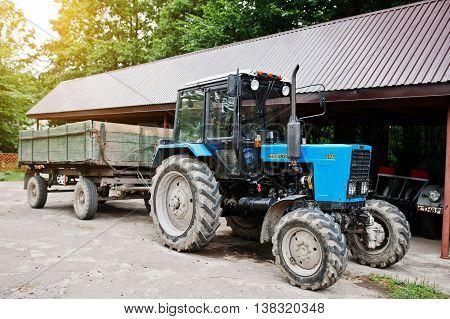Kostopil, Ukraine - July 13, 2016: Blue Belarus 82.1 Traktor With Tractor-trailer