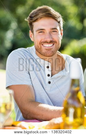 Portrait of man smiling in a park