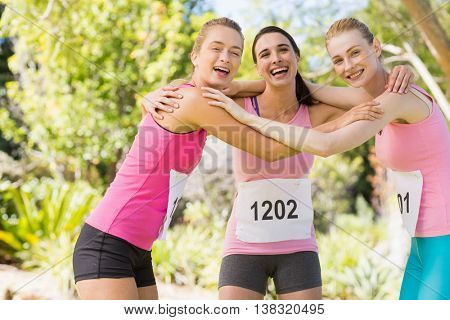Portrait of young athlete women forming huddles in park