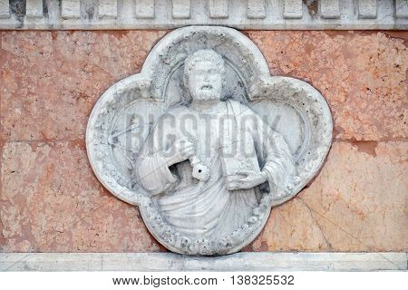 BOLOGNA, ITALY - JUNE 04: Saint Peter by Giovanni di Riguzzo relief on facade of the San Petronio Basilica in Bologna, Italy, on June 04, 2015