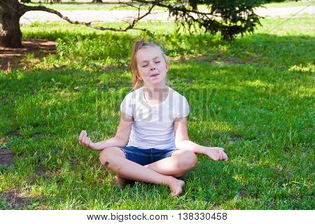Photo of cute girl in lotus pose with sore knee