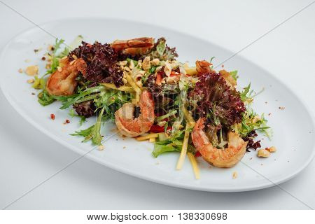 Shrimp Salad And Greens On A White Plate