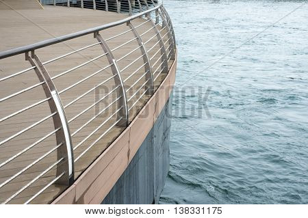 water edge with deck protected by modern metallic handrails
