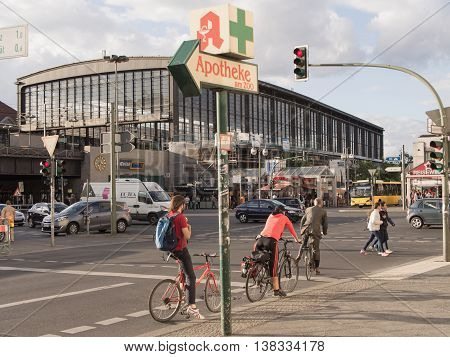 BERLIN GERMANY - JULY 6 2016: Bahnhof Zoo central station with cyclists waiting at traffic lights