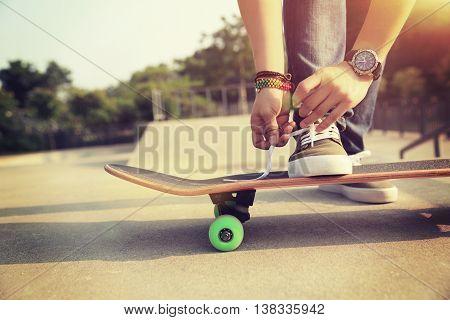 closeup of one skateboarder at skate park ramp