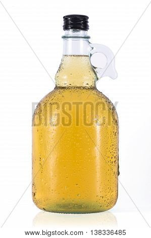 Bottle of cider with water drops on white background