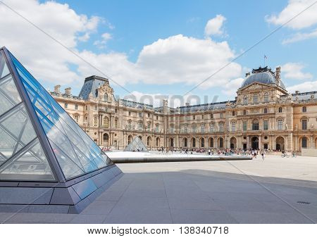 PARIS- JULY 9 : The Louvre Art Museum yard at sunny summer day on July 9, 2015 in Paris France