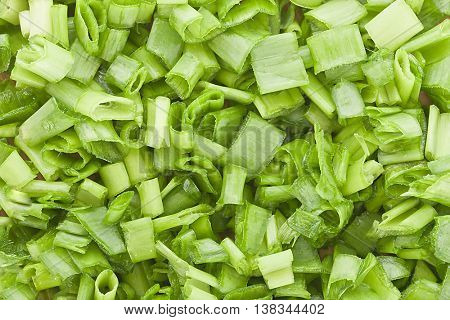 chopped green onions on background