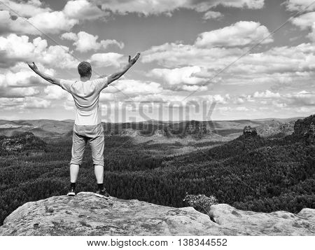 Happy Man With Open Rised  Arms  Gesture Of Triumph.