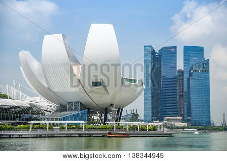 SINGAPORE - MAY 6 2016 : Cityscape of Singapore Skyline and Art Science museum at Marina Bay Sands one of famous tourist attraction in Asia.
