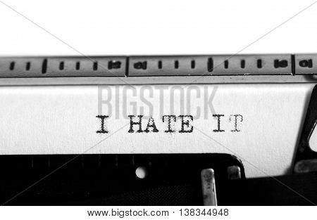 Typewriting on an old typewriter. Typing text: i hate it
