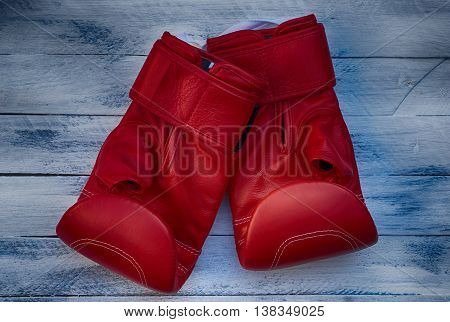 pair of red boxing gloves on the table top view vintage photos
