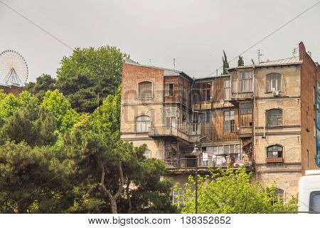 old wooden house in the ivy in Tbilisi