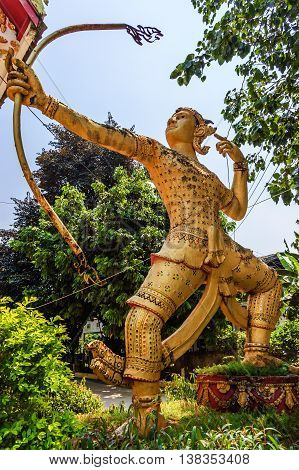 Golden statue of archer at Buddhist temple in Vientiane Laos