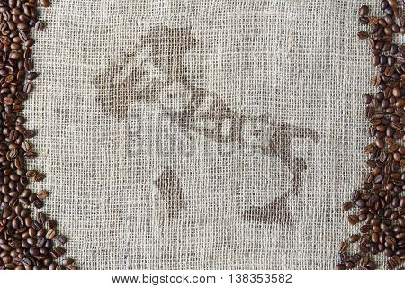 Burlap texture with coffee beans border. Sack cloth background with Italy map and word Italia on it in the middle. Brown natural sackcloth canvas. Seeds at hessian textile