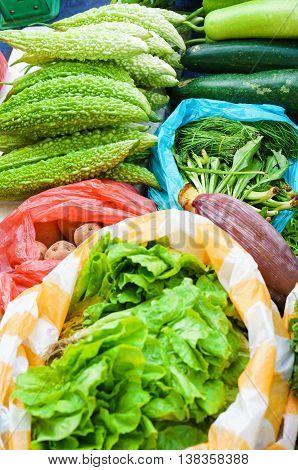 Asian Street Market Selling Fresh Lettuce And Bitter Melon