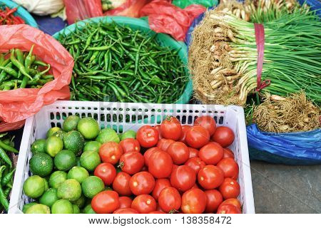 Asian Street Market Selling Tomato Lime Pepper And Greens