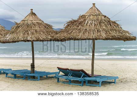 Palm Shelter And Sunbeds In The Beach In Da Nang