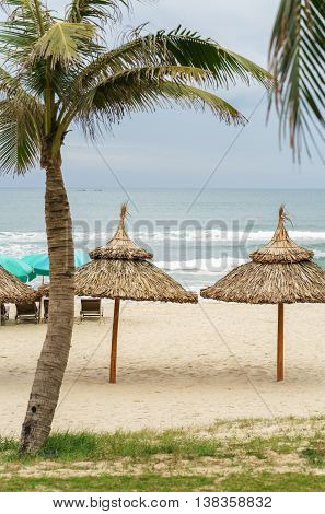 Palms Shelter And Sunbeds In China Beach In Da Nang