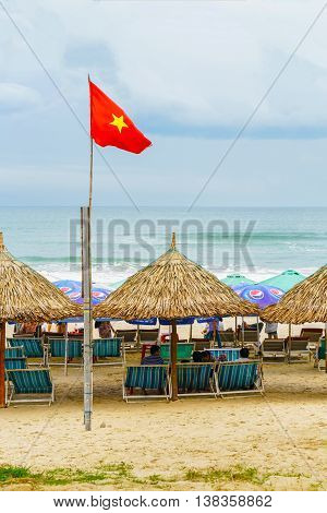 People Lying On Sunbeds In China Beach In Da Nang