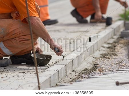 Worker Installing Curb Stones