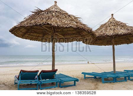 Sunbeds And Palm Shelters In China Beach In Da Nang