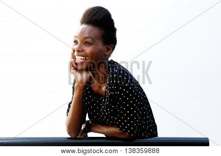 Smiling Young African Lady Leaning On Railing
