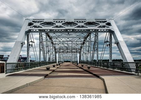 Pedestrian bridge crosses the Cumberland River in Nashville, TN