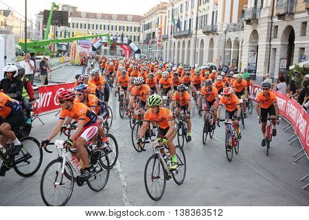 CUNEO, ITALY - JULY 10, 2016: a group of cyclists at the start of Fausto Coppi road cycling race. Cuneo, Italy, Europe.