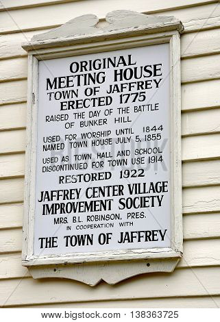 Jaffrey Center New Hampshire - July 11 2013: Town of Jaffrey historic sign on the 1775 Original Meeting House church