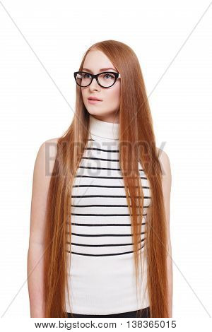 Redhead long-haired woman in eyeglasses. Young red ginger stylish girl in striped blouse. Beautiful attractive female portrait isolated at white background.