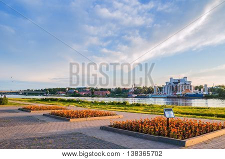VELIKY NOVGOROD RUSSIA - JUNE 21 2016. Summer panoramic architecture view - embankment along the Volkhov river and Novgorod Regional Drama Theatre at the bank of the Volkhov river in summer evening