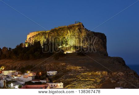 Medieval fortifications atop a rock in Lindos at night