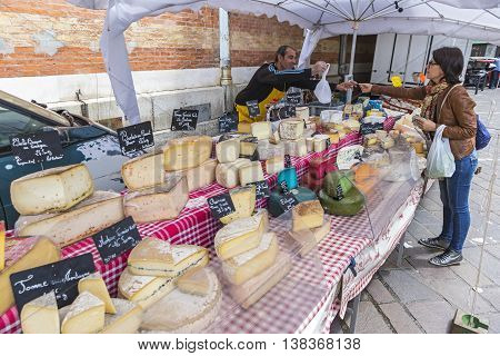 GRENOBLE FRANCE - JUNE 19 2016: French cheese sales stand at the Sunday Market in Grenoble city France