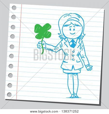 Businesswoman with four leaf clover