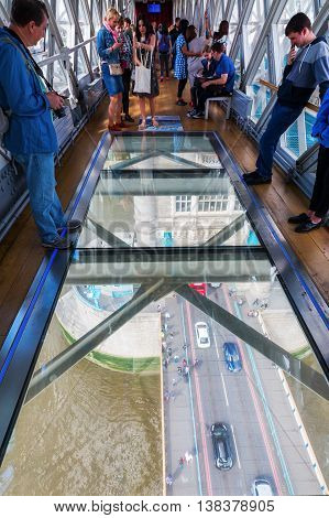 View From High-level Walkway Of Tower Bridge On The Bridge Traffic In London, Uk