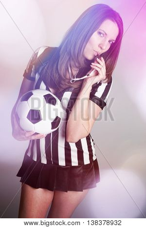 Sexy soccer referee girl holding ball