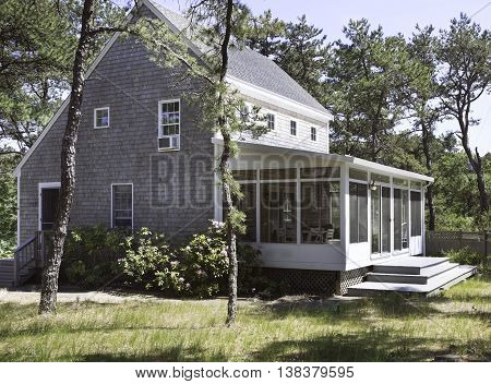 Salt box house in the forest in Wellfleet, MA on Cape Cod.