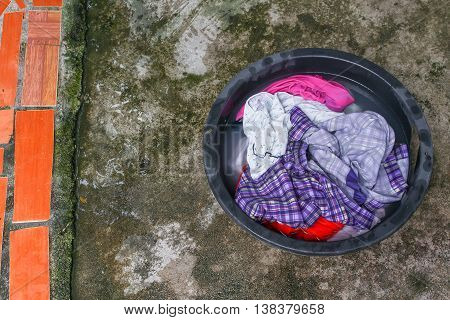 Soak dirty clothes in the basin black for cleanse Thailand washing clothes style ancient and soak with detergent in the evening.