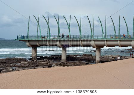 DURBAN SOUTH AFRICA - JULY 09 2016: People on the Millennium Pier at the beach in Umhlanga Rocks