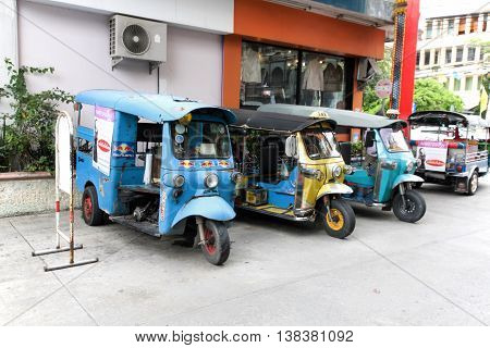 SUPHAN BURI THAILAND - JULY 10, 2016 : Motorized Tricycle Parking for passengers on the road of Suphan Buri The Motorized Tricycle are a popular way to transport in Thailand.