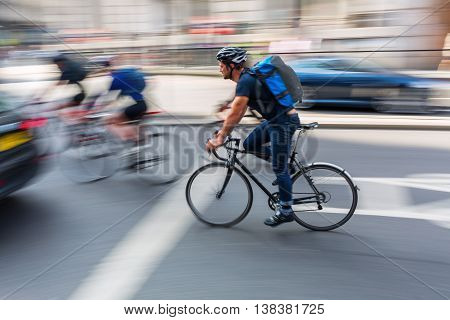 Cyclist In London City Traffic In Motion Blur