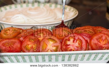 Sliced Tomatoes ready for burgers laid out in serving tray