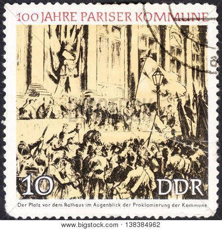 MOSCOW RUSSIA - CIRCA JANUARY 2016: a post stamp printed in DDR shows Proclamation of the Commune Town Hall Paris the series
