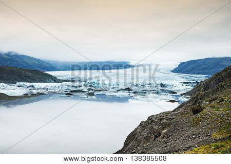 Icebergs In The Glacial Lake With Mountain Views