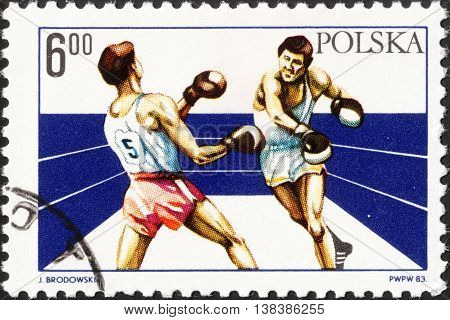 MOSCOW RUSSIA - DECEMBER 2015: a post stamp printed in POLAND shows boxing and devoted to the 60th Anniversary of the Polish Boxing Union circa 1983