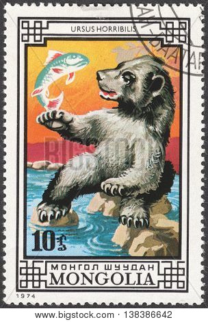 MOSCOW RUSSIA - JANUARY 2015: a post stamp printed in MONGOLIA shows an Ursus horribilis bear the series